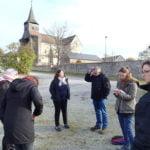 Le groupe, lors de la visite du centre-bourg de Champagnat avec les élues et l'agent municipal